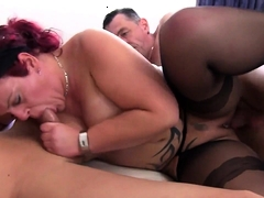 Diese Redhead Tatted Milf Takes On Two Dicks